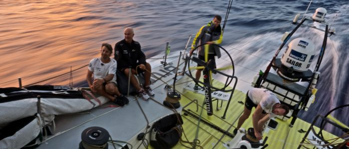 April, 2015. Leg 6 to Newport onboard Team Brunel. Day 4  Happy crew during sunset. Team Brunel did well last night and is leading the fleed. Despite three backdowns! reason for that was saragossan weed on the radders