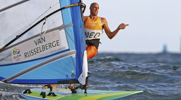2016 Rio Olympics - Sailing - Preliminary - Men's Windsurfer - RS:X - Race 10/11/12 - Marina de Gloria - Rio de Janeiro, Brazil - 12/08/2016. Dorian van Rijsselberghe (NED) of Netherlands celebrates. REUTERS/Benoit Tessier FOR EDITORIAL USE ONLY. NOT FOR SALE FOR MARKETING OR ADVERTISING CAMPAIGNS